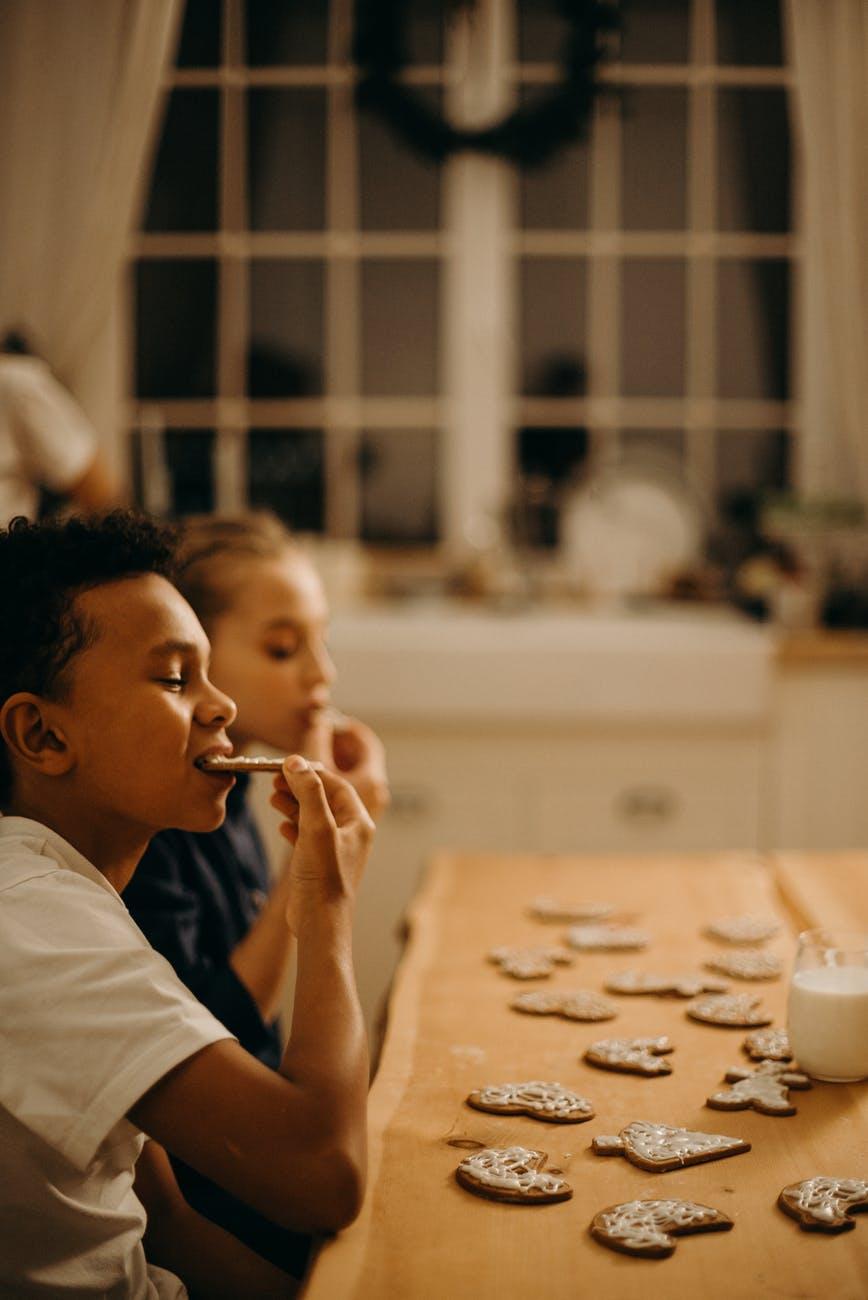 boy and girl eating cookies
